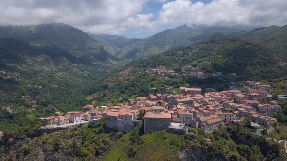 Thumbnail for Aerial Medieval Village on Cliff Overlooking Mountain Gorge, Old Town Buildings with Red Tile Roofs