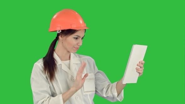 Thumbnail for Female Construction Specialist in Hardhat Having a Video Call Via Tablet on a Green Screen, Chroma