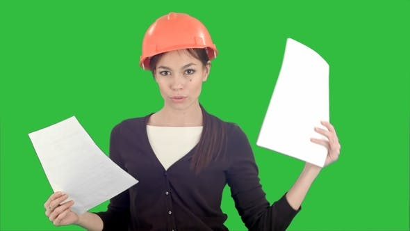 Thumbnail for Female Engineer in Hardhat Holding Papers and Doing Silly Dance on a Green Screen, Chroma Key