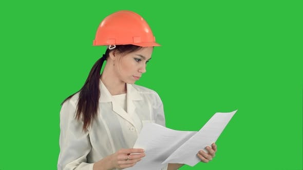 Thumbnail for Female Engineer in Helmet Reading Contract and Nodding Her Head on a Green Screen, Chroma Key