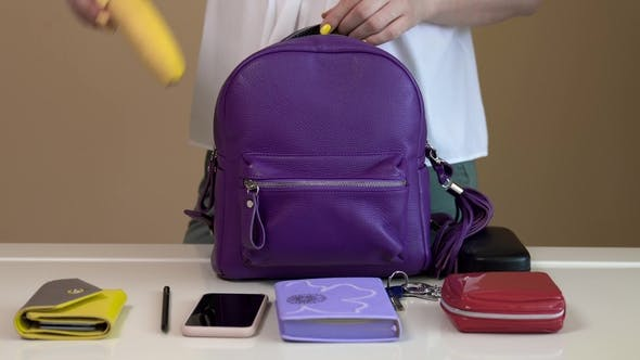 Thumbnail for A Young Woman Collects Her Bag Before Going Out. Contents of Ladies Bag