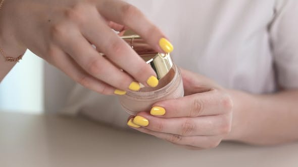 Thumbnail for of a Woman Hands Opening Loose Powder. Dipping the Brush Into the Container.