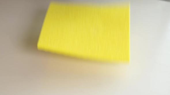 Thumbnail for Wiping a White Surface Using a Yellow Rag with Purple Gloves.