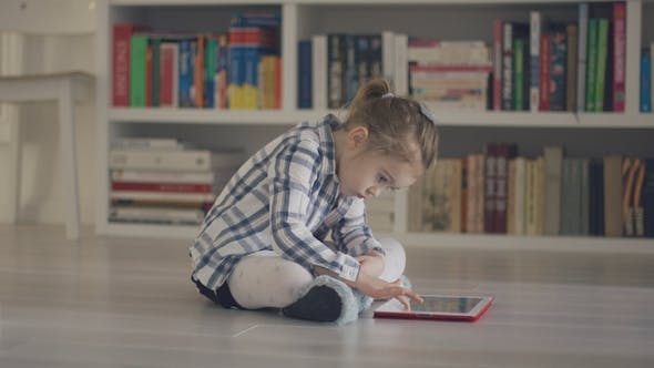 Thumbnail for Kid with Tablet on Floor