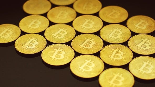 Thumbnail for Golden Bitcoins Lying in Rows