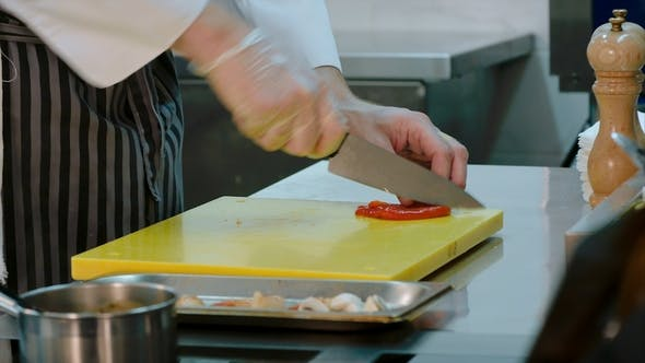Thumbnail for Chef's Hands Slicing Cured Red Bell Pepper and Putting It Together with Other Ingredients