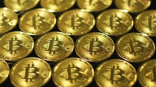 Golden Glimmering Bitcoins in Arrangement