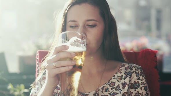 Thumbnail for Attractive Woman Is Drinking Beer in a Bar.