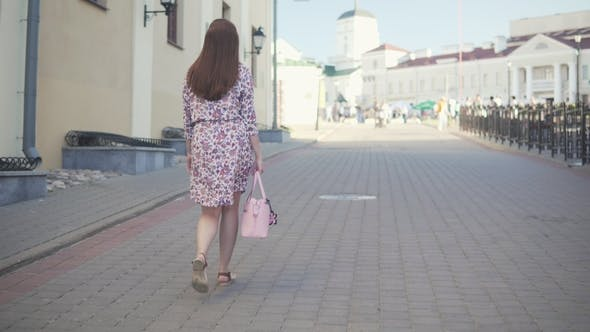 Thumbnail for An Attractive Girl Is Walking Around the City.
