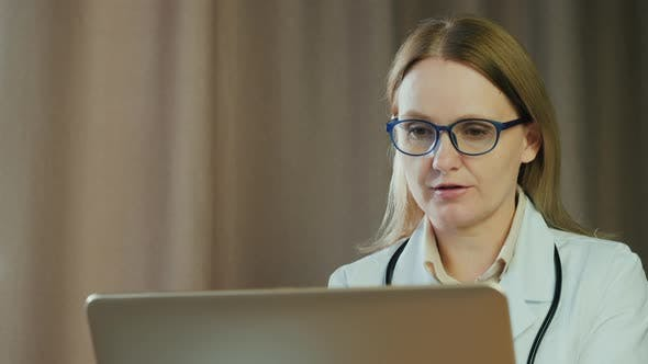Thumbnail for Doctor Advises Patient Via Video Call, Uses Laptop