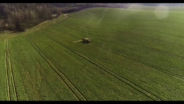 Thumbnail for Tractor Spray Fertilize on Field with Chemicals in Agriculture Field.