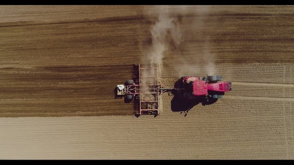 Thumbnail for Tractor Working in Beautiful Spacious Agricultural Field