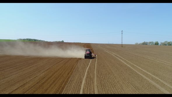 Thumbnail for Aerial of Tractor on Harvest Field Ploughing Agricultural Field