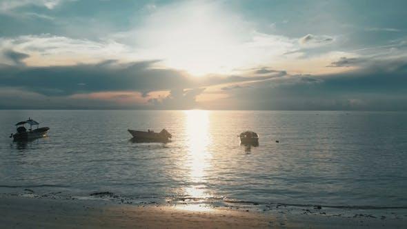 Thumbnail for Flying Over Boats Toward Sunset