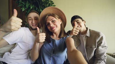Point of View Shot of  Funny Friends Taking Selfie at Home