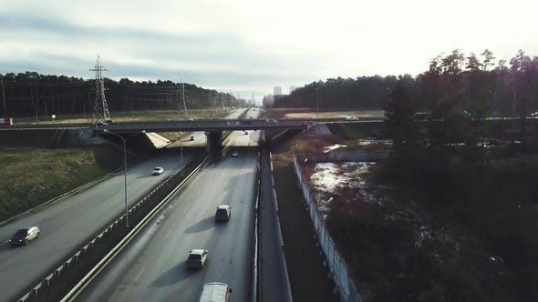 Thumbnail for Top View of the Interchange of Traffic Cars Outside the City. Video. Traffic Cars in the Country on