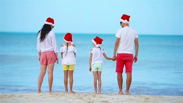 Thumbnail for Happy Family with Two Kids in Santa Hat on Xmas Vacation