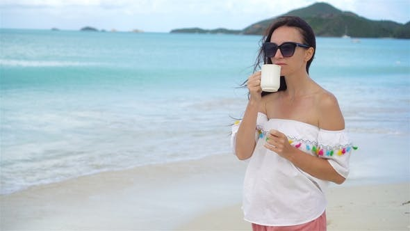 Thumbnail for Young Woman with Cup of Hot Coffee Enjoy Holidays