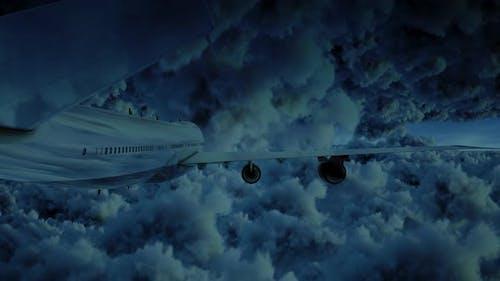 Airplane Jumbo Jet Fyling Between Storm Clouds At Night Moonlight