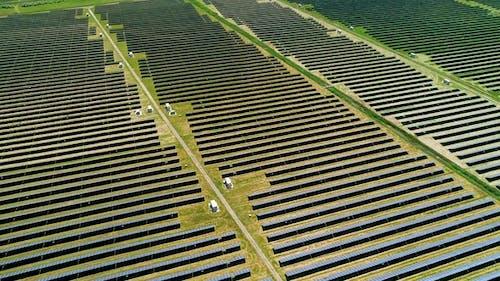 Areal Flight Over Solar Panels Field.