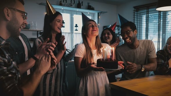 Thumbnail for Happy European Girl Holding Birthday Cake, Making a Wish and Blowing, Multiethnic Friends Sing
