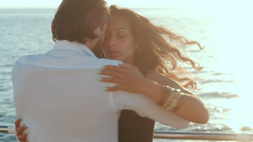 Young Hispanic Couple Dancing Latin Bachata Near Sea or Ocean