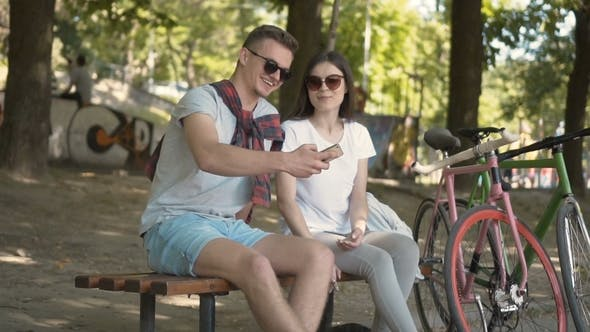 Cover Image for Couple Takes Selfie Near Bikes