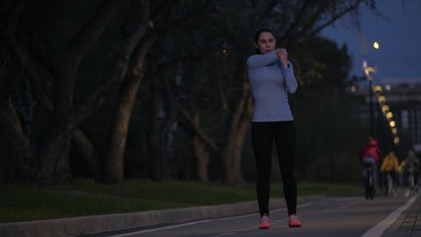 Thumbnail for Sports Girl Doing Stretching Before Training in the Evening Park. the Sportswoman Prepares for