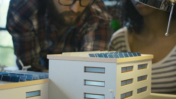 Thumbnail for Man Explaining Work Principle of Solar Battery