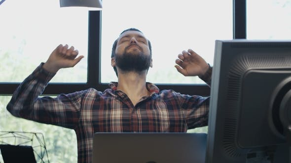 Thumbnail for Tired Worker Stretching at Working Desk