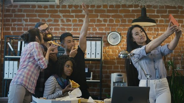 Cover Image for Cheerful Colleagues Taking Selfie with Pizza