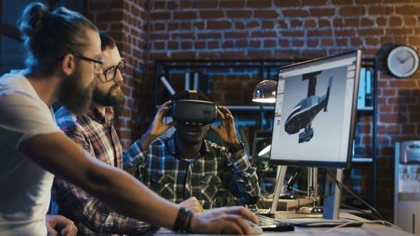 Thumbnail for Men Creating 3-D Detail for Video Game