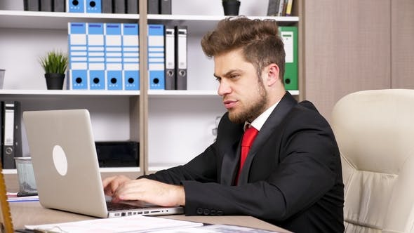 Thumbnail for Young Successful Businessman in the Office Typing on the Laptop
