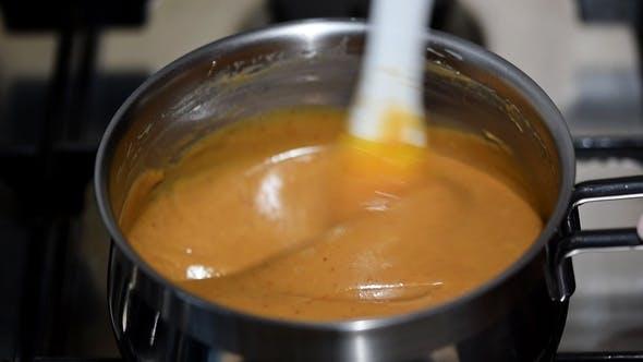 Thumbnail for Homemade Caramel Sauce. Cook Caramel Sauce in a Saucepan
