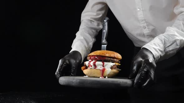 Fast Food Restaurant Food Concept. Chef Serves Prepared Tasty Burger. Delicious Cheeseburger with