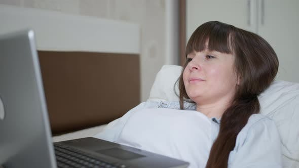 Portrait of Beautiful Girl Relaxing at Home and Ordering Fast Food Online with Internet Browsing on