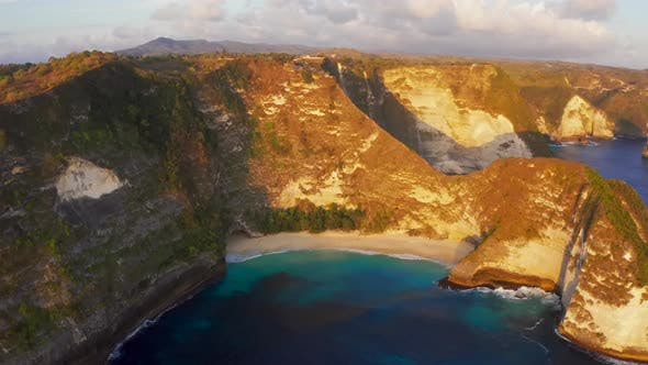 Cover Image for Aerial Drone View of Cliff and Blue Waves and Gold Beach in Indonesia at Kelingking Beach
