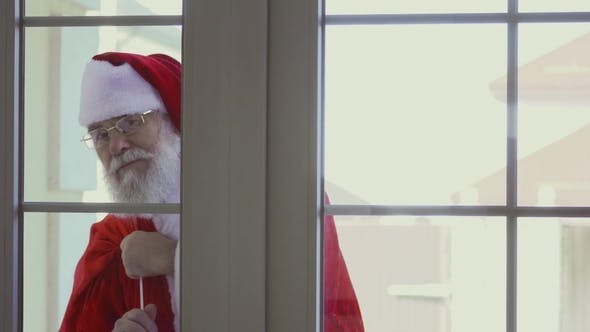Thumbnail for Santa Claus Knocking in Window