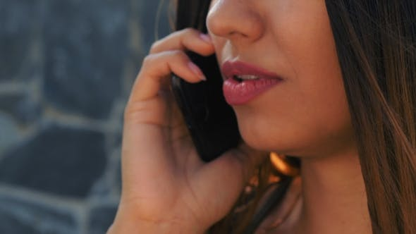 Thumbnail for of Female Mouth Speaking on Her Cellphone. Technology, Smartphone Concept. Woman Have Conversation