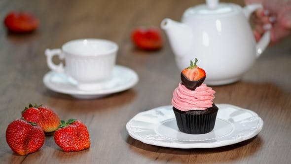 Thumbnail for Fresh Chocolate Strawberry Cupcake with a Cup of Tea.