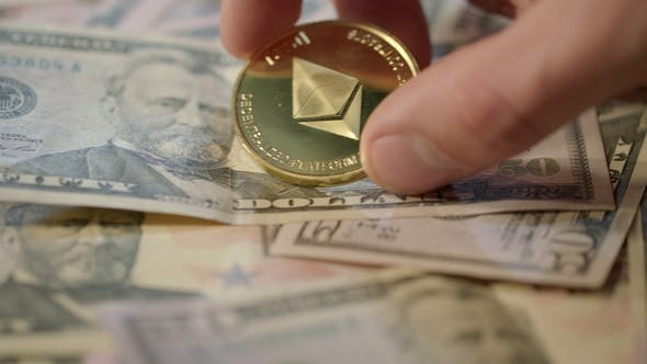 Thumbnail for Human Hand Take Gold Ethereum Coin