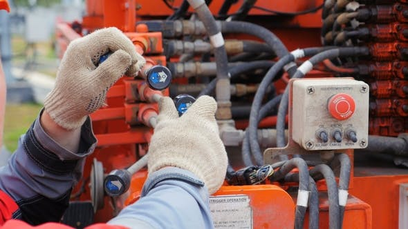 Thumbnail for Electrician Moves Control Levers in Power Box