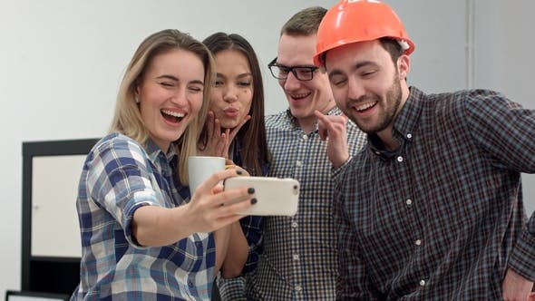 Thumbnail for Group Selfie Shot of Colleagues Having Fun in Their Office