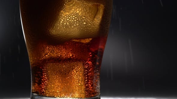 Thumbnail for Empty Glass of Ice Poured a Drink. Light From Behind .