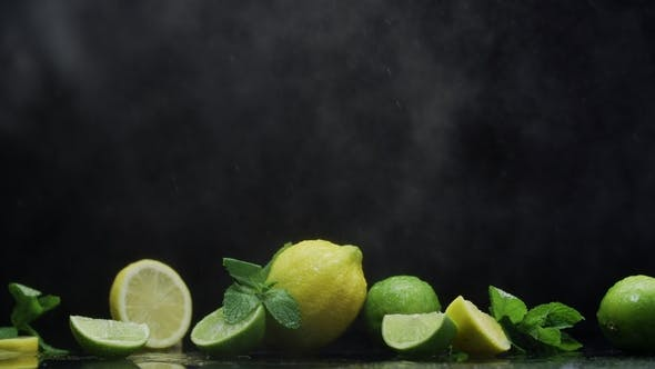 Cover Image for Dewy Citrus Fruit Lemon Lime Under Water Droplets on Water Surface Prapared for Refreshing Cocktail