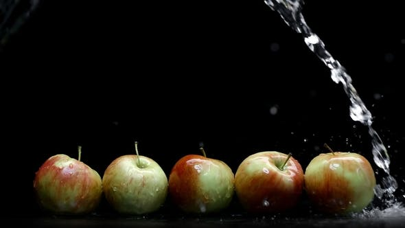 Thumbnail for Red and Yellow Apples Wash Under Water Splash with Lot of Droplets on Black Background