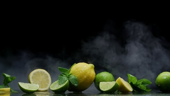 Thumbnail for Lemon and Lime Cuts in Cold Ice Clouds of Fog on Black Background
