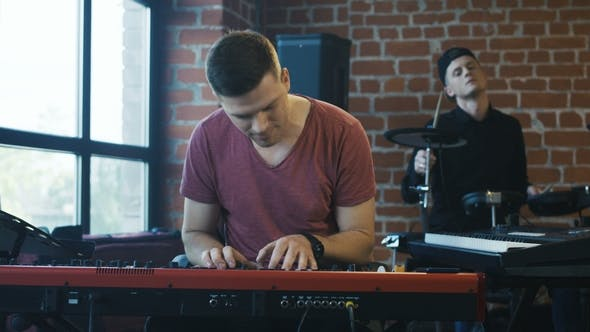Thumbnail for Men Playing Musical Instruments in Studio