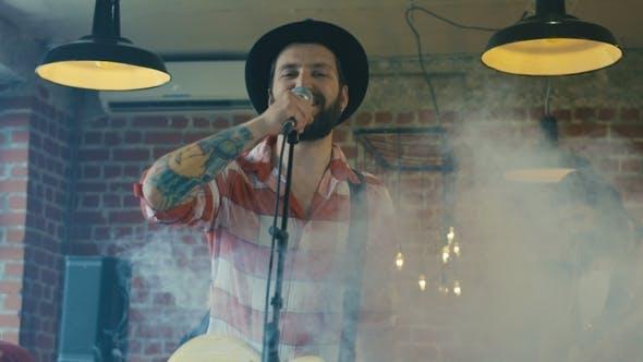 Thumbnail for Guitarist Singing in Smoke