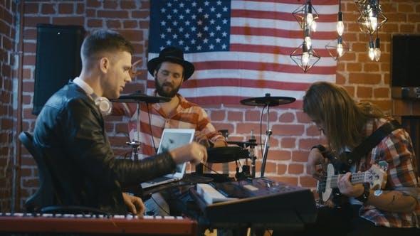 Creative Men Composing Music in Team